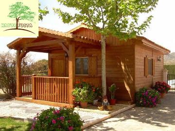 Casas prefabricadas de madera for Modelos de techos con tejas